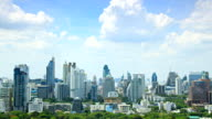 HD Timelapse:High buildings and trees the Bangkok city.(zoom in)