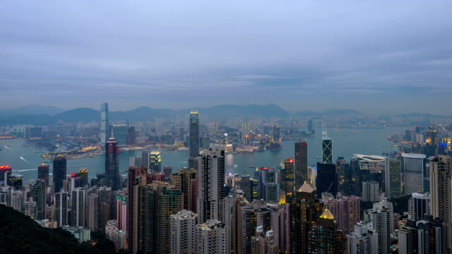 Timelapse-Hong Kong Skyline Harbour Illuminated at Twilight Vertical