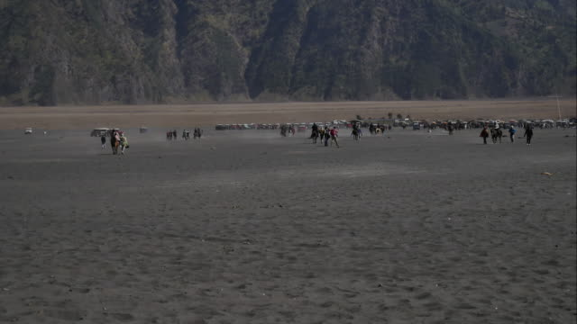 Timelapse:Horse riding service around Bromo walking from crater to the parking areas. Mt.Bromo