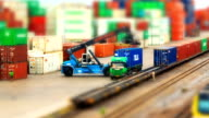 HD timelapse,miniature crane working with container on train