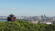 4K Time-lapse:The Chenghuang Pagoda with cityscape in background,Hangzhou,China