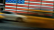 Times square american flax and taxi
