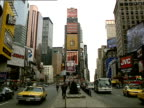 Times Square Midtown Manhattan traffic driving down Broadway amp 7th Avenue billboards highrise buildings TKTS booth BG