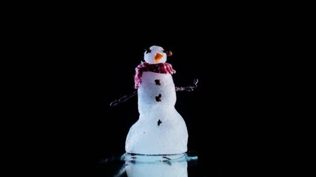Tiny Melting Snowman on Black Time Lapse