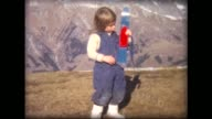 1963 tiny skis on young skier atop Chateau-D'oex, Switzerland