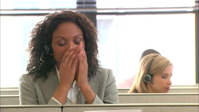CU, Tired female customer service representative in office cubicle