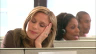 CU, Tired female customer service representative resting in office cubicle