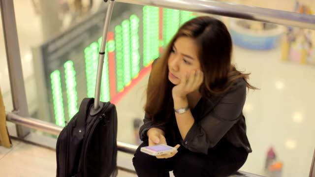 Tired female traveler waiting for departure