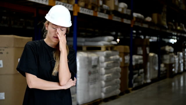 Tired woman in manufacture