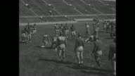Title 'AllStar College Eleven' superimposed on college football placekickers / line of men kicking / coach Bernie Bierman chewing gum / VS tackling...