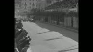 '100 Times Around Monaco Europe's gasoline demons make thousand turns in Grand Prix auto race Guy Moll of Italy averages 60 mph to win 200mile grind'...