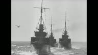 '1940' / Title card 'Invasion of Denmark and Norway 9 April 1940' / line of German warships steaming along / shot from ship in front of line of...