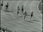 400 Meter Relay Women Won by US Time 047 New World's Record / Long pan of last leg of the relay beginning with one runner waiting at the starting...