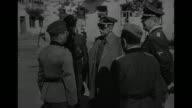 'A Visit to a Camp Near Minsk' / World War II / Heinrich Himmler Karl Wolff Erich von dem BachZelewski and Otto Bradfisch leave building / Himmler...