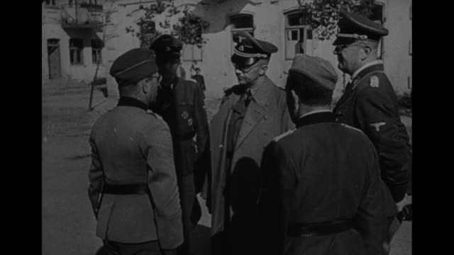 'A Visit to a Camp Near Minsk' / World War II / Heinrich Himmler Karl Wolff Erich von dem BachZelewski and Otto Bradfisch leave building / Himmler...
