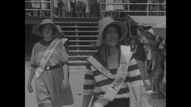 'Atlantic City N J Fetching beach costumes of yesteryear today and the future are exhibited by beauties at unique anniversary celebration' / Women in...