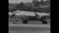 'B29 The Superfortress That Bombed Japan' / new B29 bomber taxiing and turning/ bomber takes off flying past camera / shot from plane of bomber in...