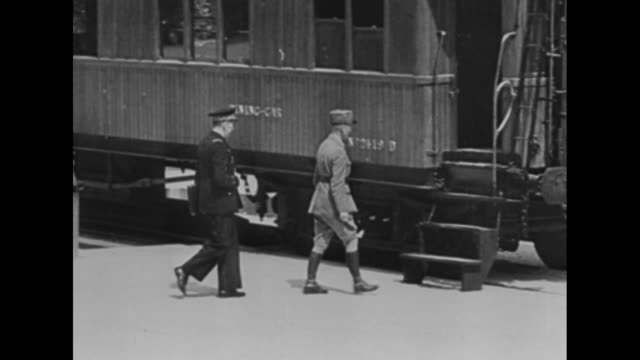 'Compiegne 22 June 1940' / WS railroad car where armistice will be signed sitting in field / two shots of Fuhrer Adolf Hitler and group of German...