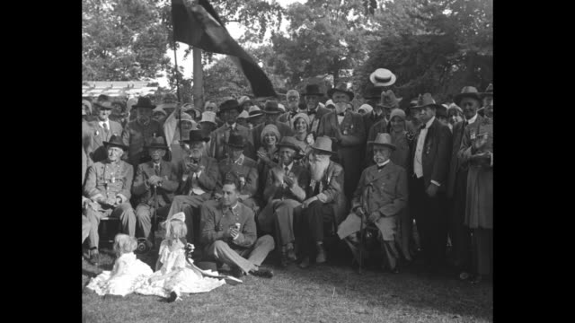 'Dixie soldiers meet once more Charlotte NC Men who carried stars and bars meet for reunion' / pan of seated Civil War veterans with one waving flag...