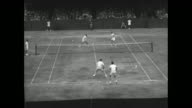 'DoublesSingles Finals WORLD STARS IN TENNIS CHAMPIONSHIPS' / MS American tennis players Ted Schroeder and Tony Trabert walk onto court with...