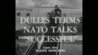 Title card 'Dulles Terms NATO Talks Successful' / CU Secretary of State John Foster Dulles walks across tarmac shakes hands with Italian ambassador...