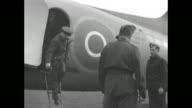'Eisenhower Visits RCAF' / Douglas C53 Skytrooper transport plane taxis on airstrip / Eisenhower deplanes followed by British Air Marshals Trafford...