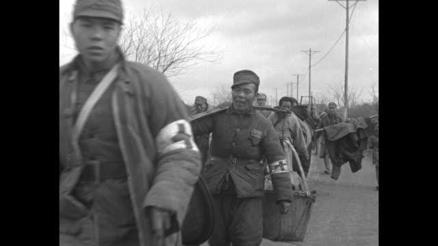 'First pictures of evacuation of battered Shanghai by Chinese troops' 'Editor's note These scenes filmed in the heart of the recent fighting zone...