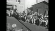 'France US troops liberate conscript Russians' / VSMS elevated view of Russian conscript women hailing US military trucks passing by / MS ground view...