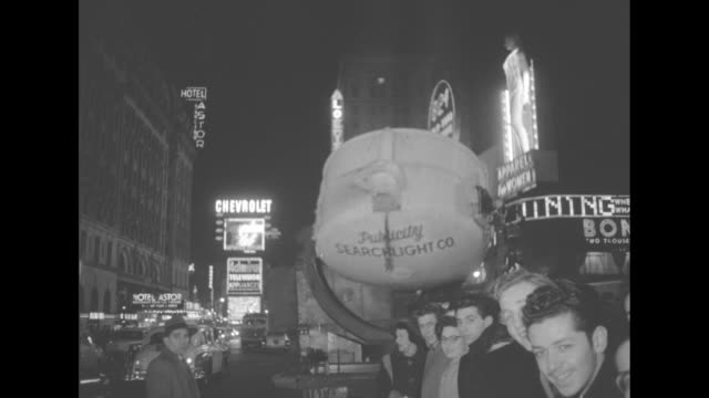 'Gala Premiere Salutes 'Eddie Cantor Story'' superimposed over street scene in front of theater in Times Square New York / Night EXT Paramount...