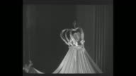 'Grace Kelly and Prince are Stars at Ball' superimposed over WS the ballroom at the WaldorfAstoria in NYC site of the 'Imperial Ball A Night in Monte...