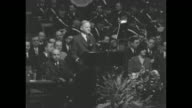 'Hoover Hits Political Foes President answers Democratic charges in Cleveland Republican rally' / Herbert Hoover at podium at Public Hall with group...