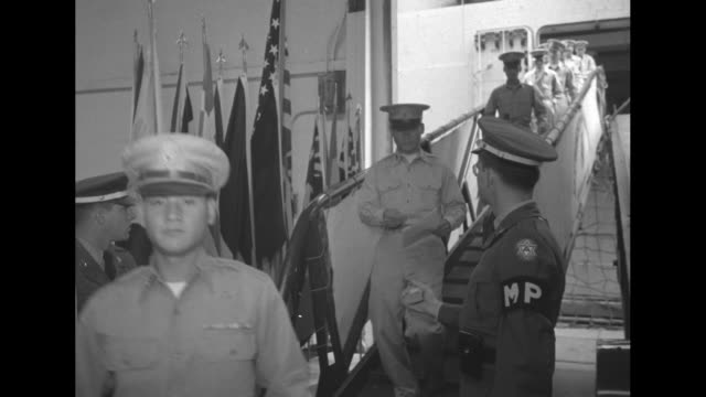 Title card 'Korean Republic Officers in US for Training' superimposed over officers in classroom / VS South Korean officers down gangway from ship /...