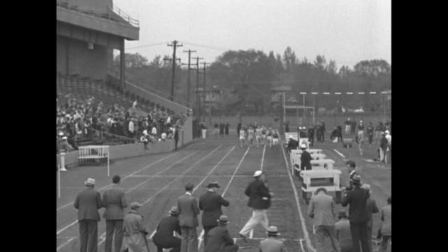 'Michigan big ten track champ Indiana and Ohio State give leader close battle in meet at Evanston ILL' / VS 440 yard dash with shot of crowd / men at...