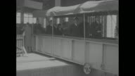 'New York City' superimposed over long shot of Capt John C Towney escorting Japan's Yasuhito Prince Chichibu and Setsuko Princess Chichibu to the...