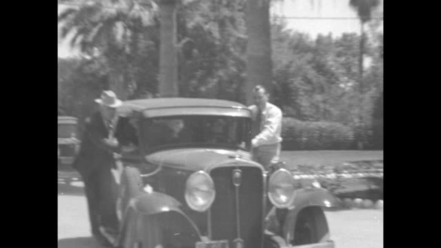 'News Flashes' / car carrying convicted murderer Winnie Ruth Judd driving towards camera guards standing on running boards on either side / Judd...