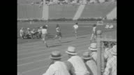 'Olympic Champions in Action Records fall on field and track as star athletes show their speed' / crowd in stands at 1932 Summer Olympics at Los...