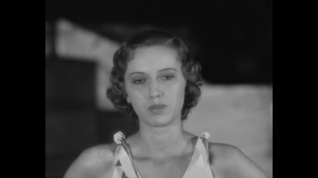 'Pathe News Presents Beauty Contest Winners' / woman in shorts set walking on and down stage / CU Catherine Louise Berger introduces herself / man in...