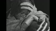 ñPreserved in Ice 500year old Inca Childî superimposed over mummy / CU Incan mummy girl seated hunched over / woman removing blanket from mummy and...
