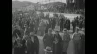 'Race Season On For 1933 Speedy thoroughbreds stir fans at Agua Caliente track in Mexico' / shot of crowd on grounds and in stands at Agua Caliente...
