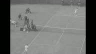 'Sports' / Title 'The Davis Cup' superimposed over spectators / CU Australia's Lew Hoad and America's Tony Trabert facing camera then walking away /...