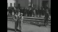 'Stimson War Secretary Visits Fifth Army In Italy' / US Secretary of War Henry Stimson and his party coming down steps of Piazza Garibaldi in Naples...