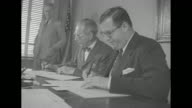 superimposed on Abba Eban and John Foster Dulles 'USIsrael Sign Treaty of Friendship' / left profile of Eban and Dulles signing documents / Eban w...