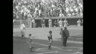 'The Dodgers Win' superimposed over crowd in stands / shot of stands and ball field / Yankee player Tommy Byrne winds up and pitches / Dodger Roy...