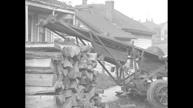 'This is Odd but it Cuts Wood Even Portland Ore Inventor discovers way to make kindling with a housetohouse sawmill' / car with trailer bearing...
