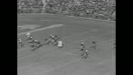 'Tiger Tamers' / GV Yale Bulldog football team starts game at Palmer Stadium with kickoff Princeton Tigers player drops ball recovers and is tackled...