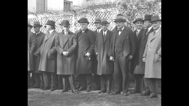'US Leaders Meet on Trade Washington Ford and Mellon in group at White House conferring on business' / slow pan line of industrialists wearing hats...