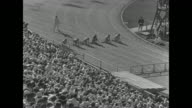 'US piles up lead Los Angeles 12 world's records fall America's track and field stars continue supremacy in 10th Olympiad' / WS pan of filled stadium...