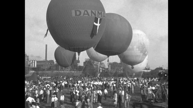 'US Victor in Balloon Classic St Louis MO Entries from Six Nations Compete in 18th Race for Bennett Trophy' / MS Danish balloon in foreground others...