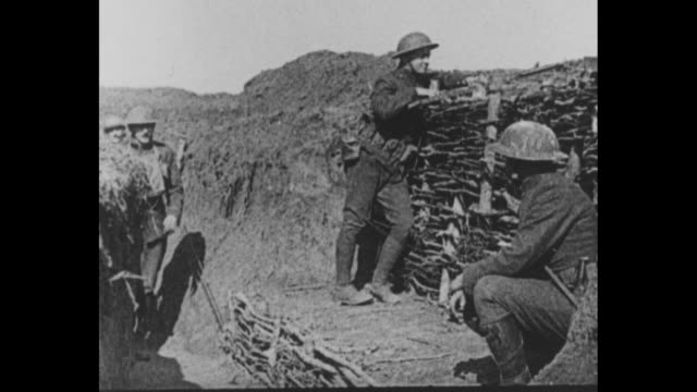 'With The Stars And Stripes Over There Official US War Films' / World War I / US doughboys in France / soldiers on the front lines / CU 2 soldiers...