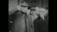 Title card 'World Mourns Marshal Joffre A Soldier of France Paris Hero of the Marne Dies at the Age of 78' / CU Joffre in uniform saluting / Joffre...